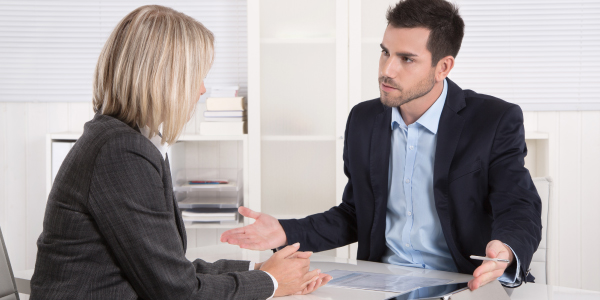 Workplace Counseling - Younger Man Explaining