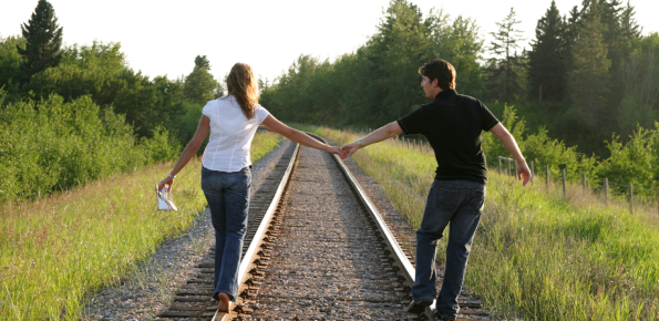 Holistic Counseling - Couple Walking on Train Tracks